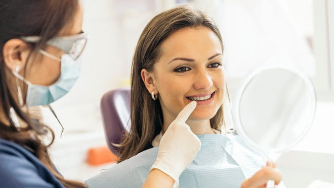 Dentists with a patient during a dental intervention. Dentist  Concept