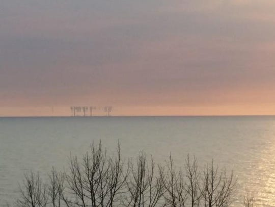 A mirage of Chicago skyline upside down startled campers