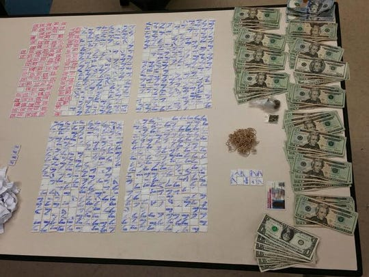 Howell police say they seized $1,500 and more than 900 doses of heroin in a drug bust.