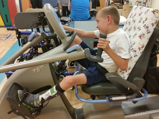 Braden Gandee, 9, during a therapy session weeks after