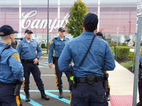 New Jersey State Police troopers gather outside Campbell Soup Co. headquarters in Camden, which holds the state's Unified Command Post for the visit of Pope Francis.