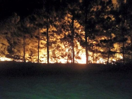 Wildfire in Navarre near U.S. 87 and U.S. 98.