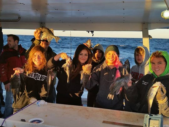 Members of the Barengat High School Fishing Club on their annual sea bass trip last Friday.