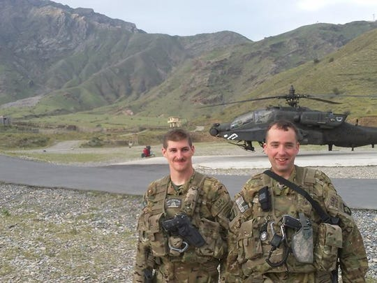 Chief Warrant Officer 2 Kevin M. Weiss, left, with Chief Warrant Officer 4 Sean Gold in Torkham, along the Afghanistan-Pakistan border in 2014.