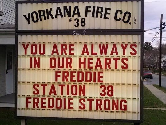 A sign outside the Yorkana Fire Company station this week remembering firefighter Freddie Kemfort.