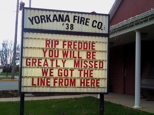 A sign outside the Yorkana Fire Company station remembering firefighter Freddie Kemfort.
