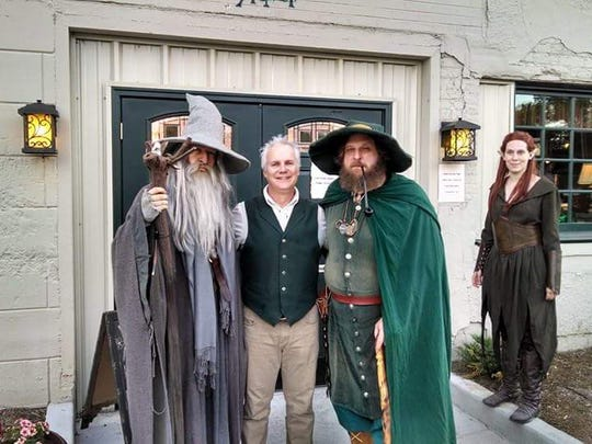Standing in front of the Green Dragon Public House are members of the Tolkien club posing as characters, from left, Gandalf, Green Dragon owner Joe Minter as Bilbo, Radagast the wizard and Tauriel the elf.