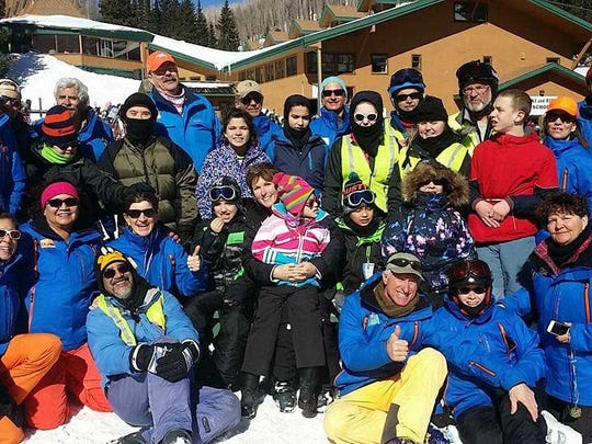 A group of 57 people, including 12 children, their families and friends, recently participated in the Ski Apache Adaptive Sports program.
