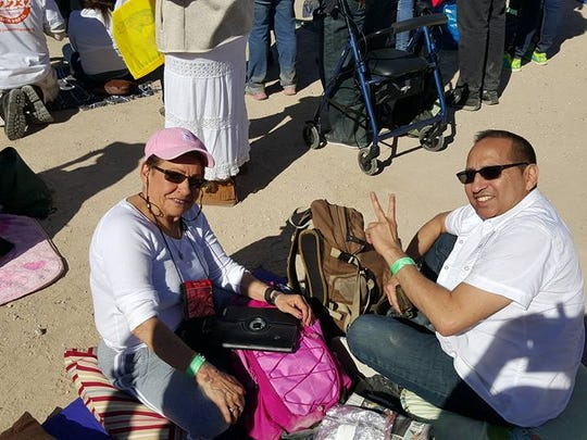 Miranda Darcy and Saulray Sanchez wait for the arrival of Pope Francis at the Estadio Benito Juarez.