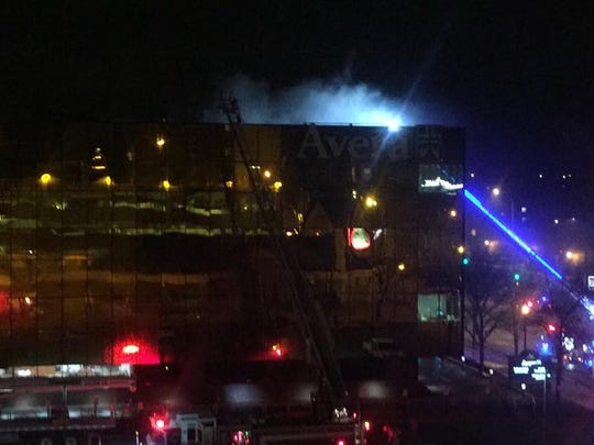 Smoke is seen rising from the Avera IT building in downtown Sioux Falls on Friday night.