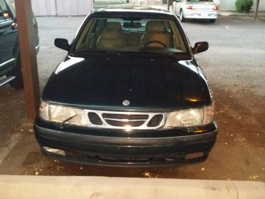 Police are searching for this green Saab after a group