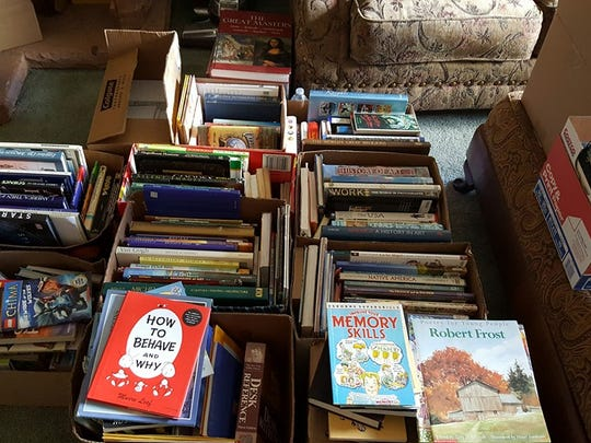 Books donated to the Hildale public library are shown