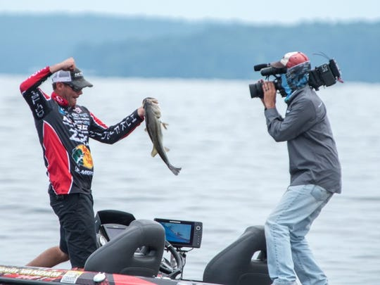 Basmaster Elite angler Kevin VanDam celebrates catching a big Toledo Bend bass that helped him win an Elite Series event on Toledo Bend in May.
