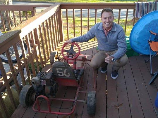 Daniel Hemric is seen with his childhood go-kart.