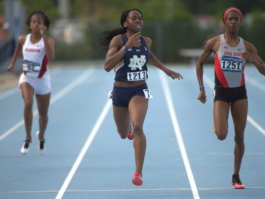 Notre Dame sprinter Margaret Bamgbose (center)