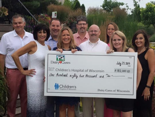 Dairy Cares presents a check for $182,000 to Children's