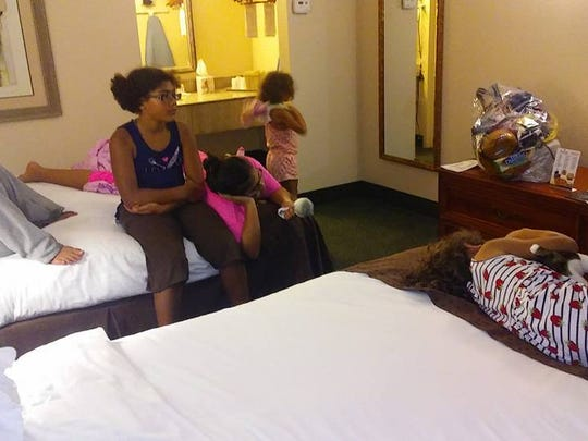 This family was evacuated and made it to a hotel room.
