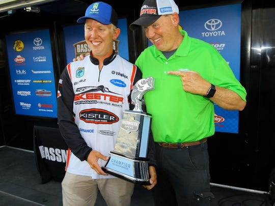 Alton Jones Jr. enjoys a smile with his father, fomer Bassmaster Classic champ Alton Jones during Saturday's weigh-in at the Bossier City Bass Pro Shops.