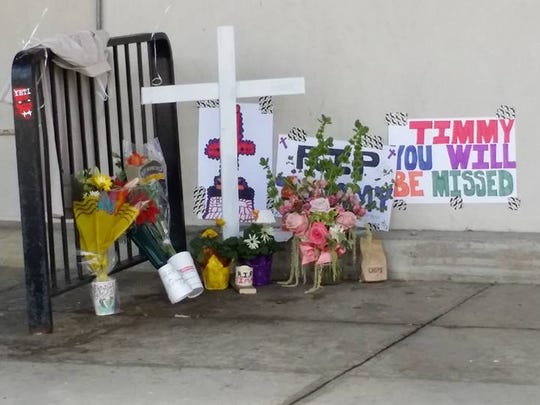 A makeshift memorial sits outside the shuttered Pathmark