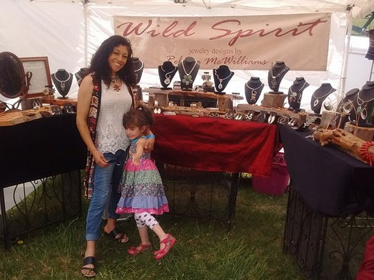 Rebecca McWilliams and her five-year-old daughter in her Wild Spirit booth.