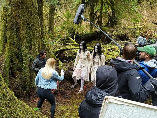 Laura Flannery, as Jordan, faces the ghostly twins, played by Nikita and Jade Ramsey, at Silver Falls State Park.
