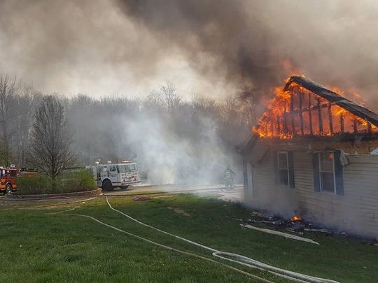 Smoke was visible for miles as crews battled a blaze at a home on the 5300 block of Pleasant Chapel Road Monday morning.