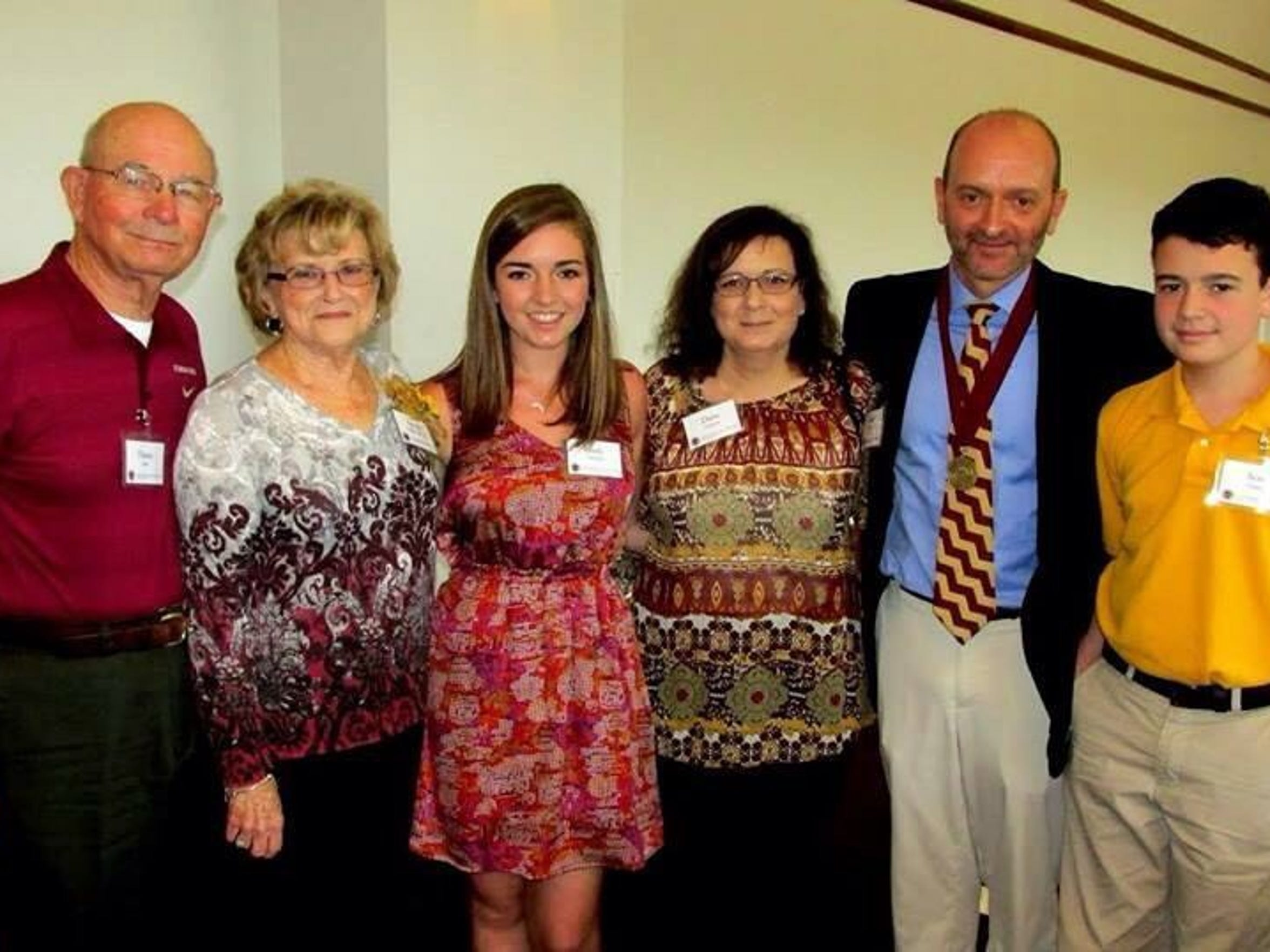Pictured from left to right: My grandparents, Grand-Danny and Nanese; me; my mom; Mark; and Scott. Picture taken when Mark was inducted into the Circle of Gold during the spring of my freshman year.