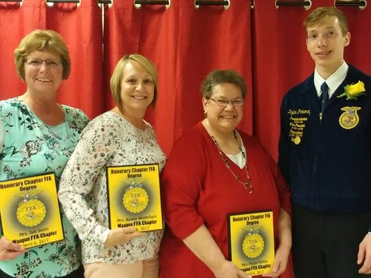 Waupun FFA President Dylon Pokorny congratulates WAHS Office Staff members, from left, Deb Smits, Bonnie Winterhack and Peggy Pattee with the Honorary Chapter FFA Degree at the recent Waupun FFA Banquet.