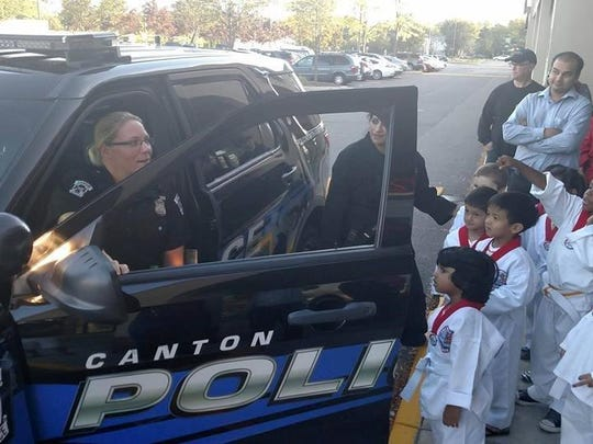 Officer Patty Esselink talks with martial arts youngsters