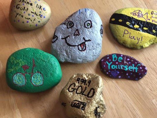 Playing hide-and-seek with hand-painted rocks has become