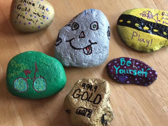 """Playing hide-and-seek with hand-painted rocks has become this summer's """"big thing."""" Community group members decorate and hide rocks around towns — in safe, public spots — for others to find and rehide. #HillsboroughROCKS"""