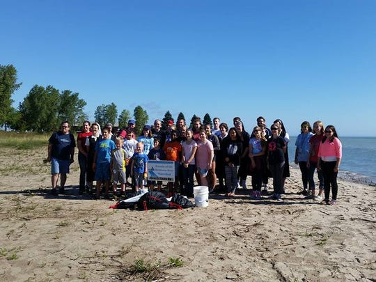 Friends of the Manitowoc River volunteers pose for a photo after the 2016 beach cleanup on Manitowoc County beaches. More than 5,000 pounds of garbage has been cleaned up in Manitowoc County alone.
