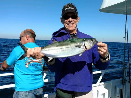 Mitch Sewell with a bonito caught on the Queen Mary