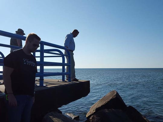 U.S. Army Corps of Engineer Detroit District staff inspect the Two Rivers pier in summer 2015, when the need for emergency repairs was first discovered by the U.S. Coast Guard.