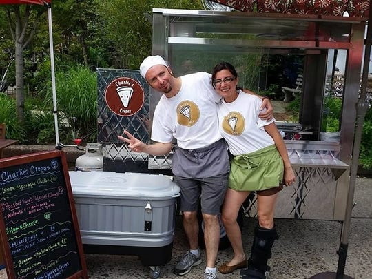 Lisa and Charlie Koory share a laugh in front of their crepe truck at the Collingswood Farmers Market.