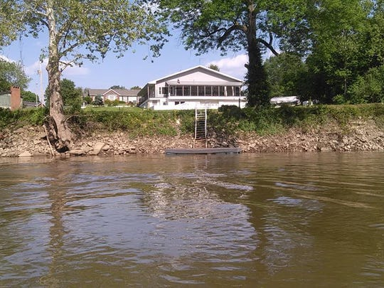 A view of Tom Baer and wife Lisa Jo's home, formerly the Forth Harrison Boat and Saddle Club, from the Wabash River where they live in Terre Haute. The Baers have lived in their home for 25 years but have never been contacted by Duke Energy about being at risk or potentially flooded with toxic waste should a dam around the coal ash pits at Duke's Wabash River power plant fail.
