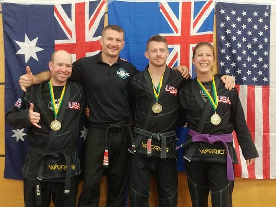 Aaron Behr, Shawn Chitwood, Craig Chitwood and Katie Seher with gold medals won in grappling.