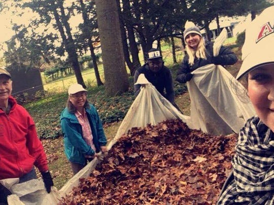 "Community members Lisa Payne and Jon Kirkwyland join Tompkins Cortland Community College students Kait Tagliaferri, Lara Patz and Javourghn Mckenzie raking leaves for neighbors during a community service day ""Raking in the Good Deeds."""