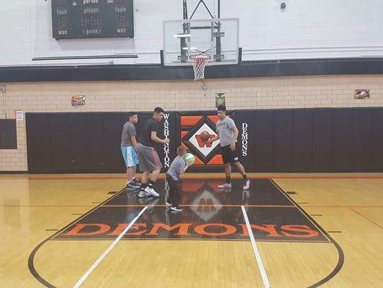 Jayce Crowder (front) plays basketball with Trashaun