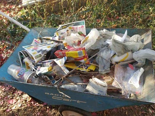 Black Friday litter is thrown into a family yard