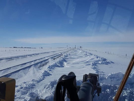 High winds caused heavy drifting and closed roads in
