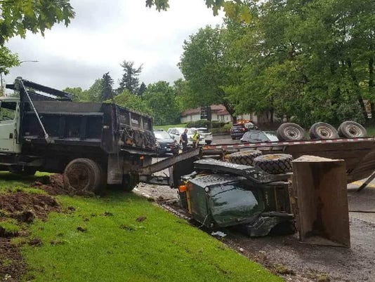 Clarkstown dump truck rollover