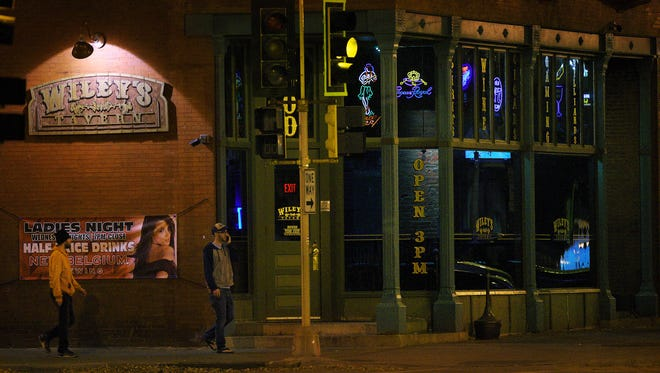 Patrons walk to Wiley's Tavern in downtown Sioux Falls on Thursday, November 3, 2016.