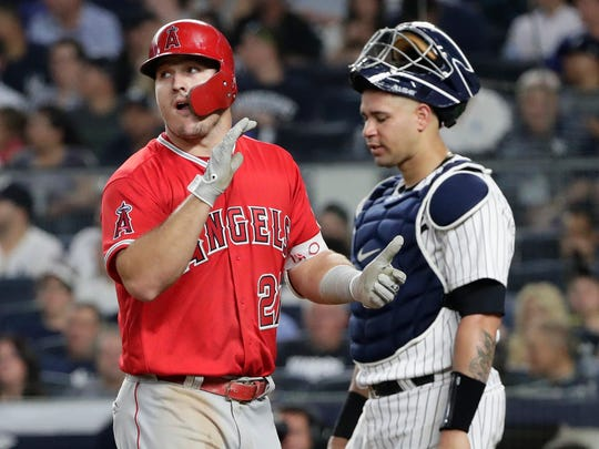 Los Angeles Angels' Mike Trout (27) walks past New