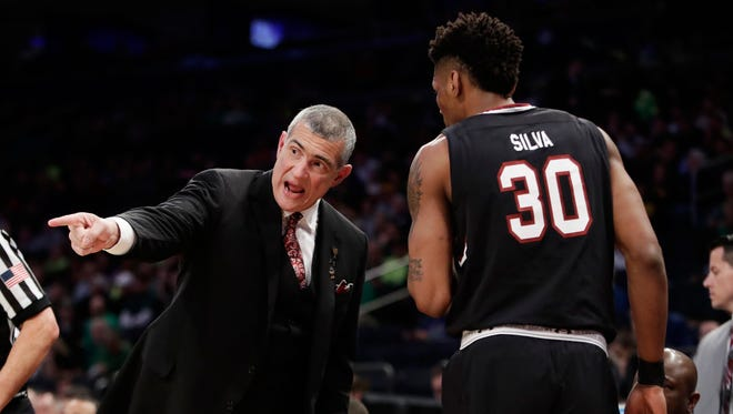 South Carolina head coach Frank Martin gives instructions to forward Chris Silva (30) in the first half of an East Regional semifinal game against Baylor in the NCAA men's college basketball tournament, Friday, March 24, 2017, in New York. South Carolina won, 80-50.