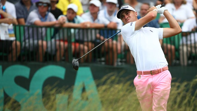 Justin Thomas plays his shot from the first tee during the third round of the U.S. Open golf tournament at Erin Hills.