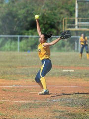 Guam High pitcher Kaylee Camacho winds up for a pitch against the John F. Kennedy Islanders during their Independent Interscholastic Athletic Association of Guam Girls' Softball game at Tiyan field on Jan 23.