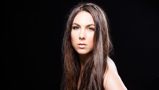 Swedish pop-metal band Amaranthe features three singers, including Elize Ryd.