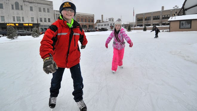 Sam Siikarla, 11, left, and his 9-year-old sister Allyson, both of Wausau, enjoy ice skating Jan. 27, 2015, on The 400 Block in Wausau.