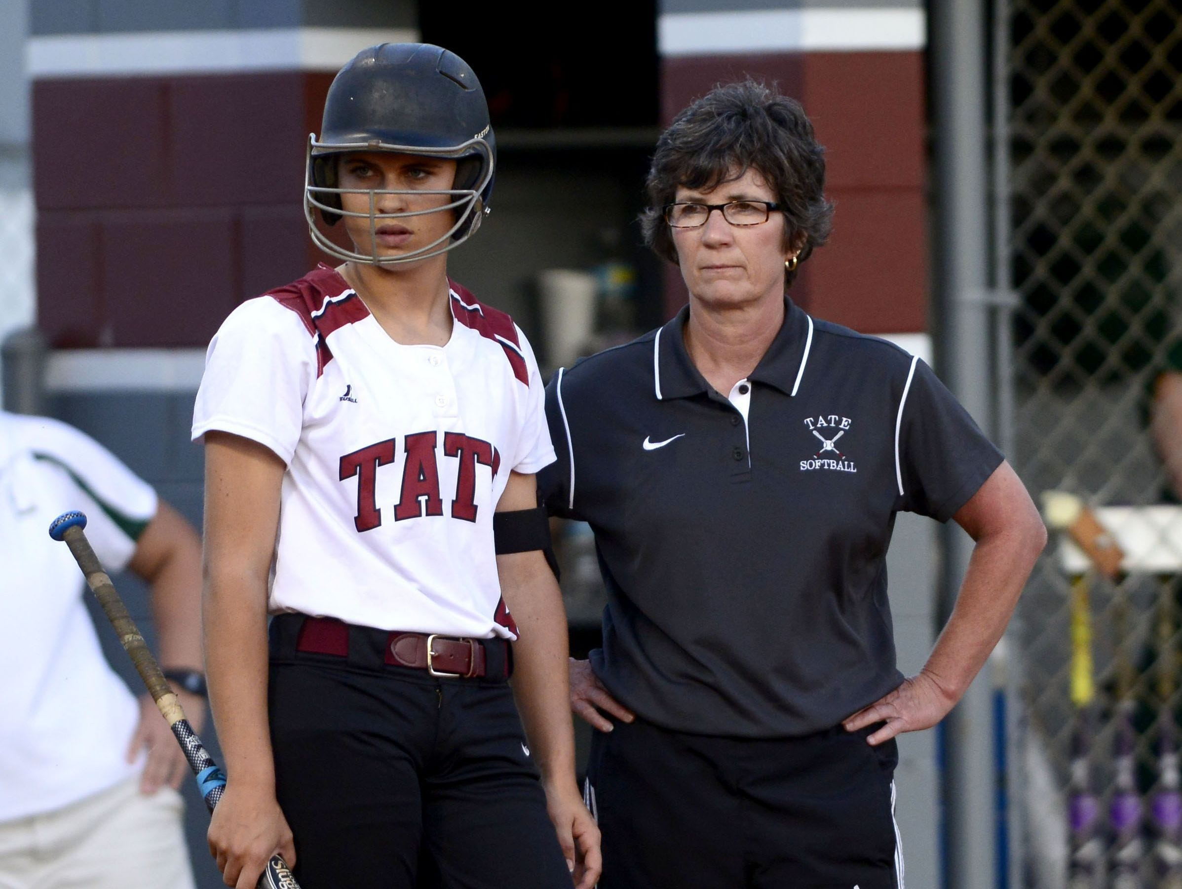 Tate's Savannah Rowell and head coach Melinda Wyatt survey the field from behind a baseline during competition last season.